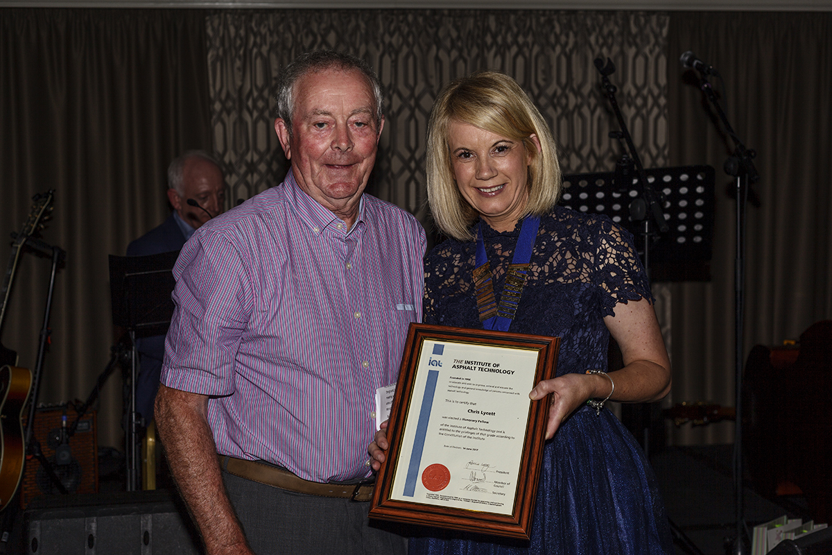 Chris Lycett receiving his Honorary Fellowship from Geraldine Walsh